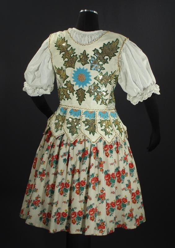 a stunning handmade folk costume vest from southern Poland or northern Slovakia in the Orava region in the Carpathian Tatra Mountains. The vest is decorated with traditional design of the mountain flower of the Thisle family. Beautifully beaded and sequined, and likely dates to the 1950s. The colorstend to indicate that this was a wedding vest and made by a woman for this very special occassion. Laces up the front with a lovely matching blue ribbon. (Back view). Poland | eBay