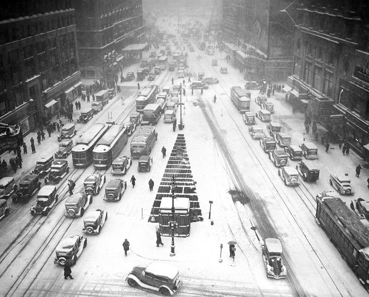 Times Square is covered in a white blanket during snowstorm on Jan. 24, 1935.