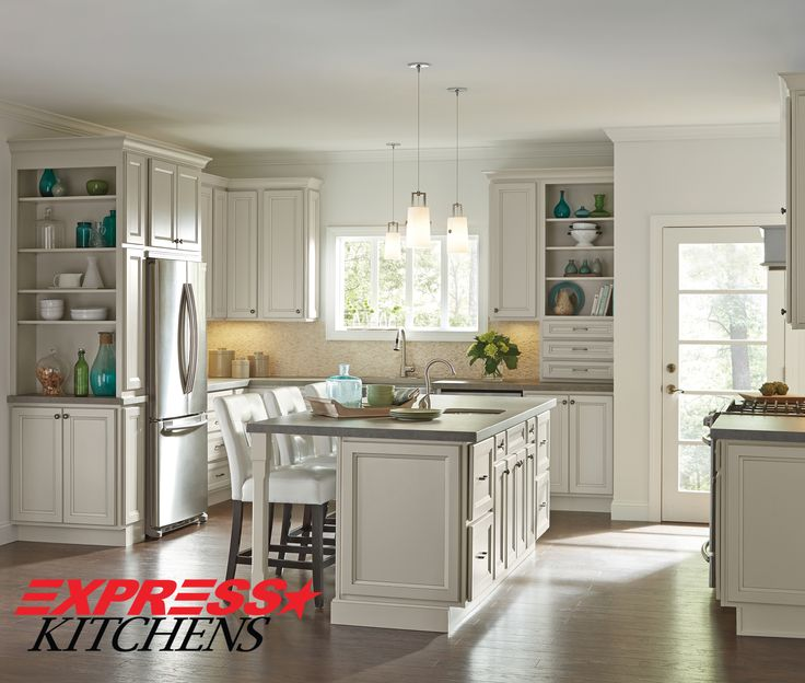 These Creamy Glazed Cabinets And Warm Wood Floors Join Seamlessly With Subtle Architectural Accents In This Casual Kitchen By Homecrest