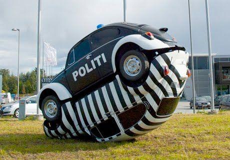 COPS n ROBBERS  Art Car Central | Art Cars | Art Bikes | Art Vehicles | Videos: Cop and Robber VW Art Car Sculpture by LInda Bakke