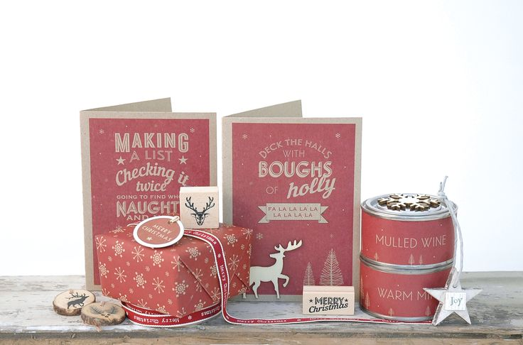 East of India Stag Christmas cards and red tin candles. Lovely wrapped presents.