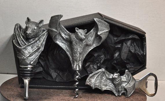 "Fruit Bat Wine Accessory Gift Set Includes: Fruit bat, or flying fox winestopper, corkscrew, and bottle opener packaged in a 8"" tall black coffin gift box  By: Dellamorte & Co.  A unique handmade gift for the dark soul in your life."