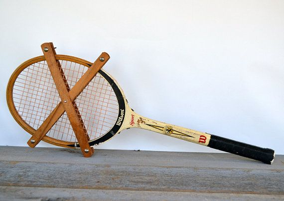 Wilson Sport Wood Tennis Racket with unusual cross press.  Great old Wilson wood tennis racket sports an unusual cross press. It measures 27 long and is in used vintage condition. Marked Wilson Sport.  Perfect for display in your home office, family room, office, man cave or game