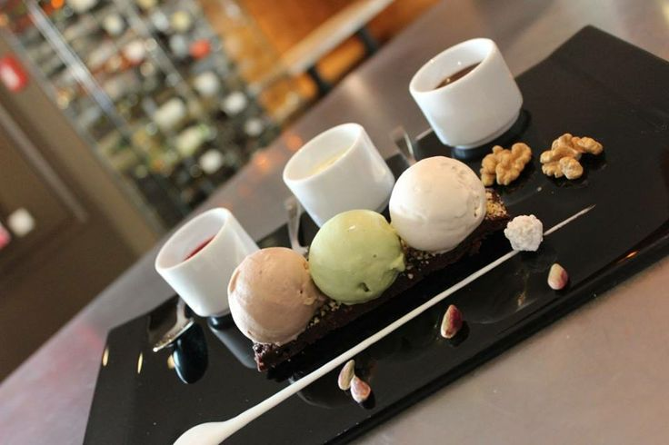 It's the perfect way to stay cool on a summer day. Our trio of pistachio, chocolate, and walnut ice cream served on a Valrohna chocolate biscuit.