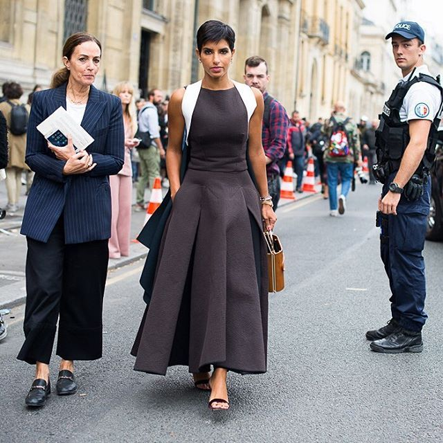 Pleats, please: outside the Chalayan show, a long dress on Deena Aljuhani Abdulaziz gets more volume from kick pleats. Photo by @gastrochic #PFW #fashion #streetstyle