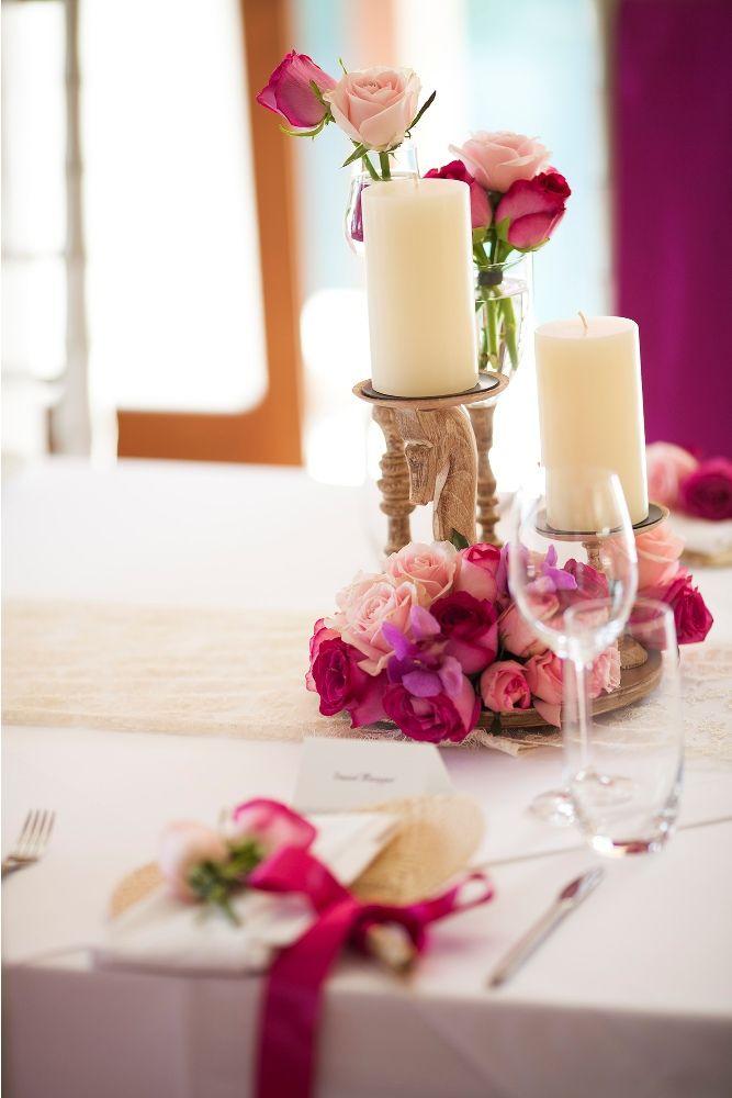 Hot pink adorning the Bridal Table by Tirtha Bridal Uluwatu Bali