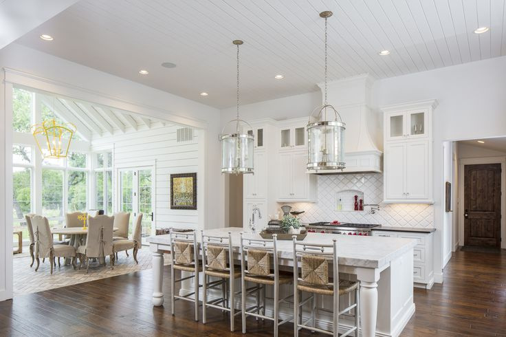 kitchen goals? We think yes. This clean look mixed with a bold look like a yellow chandelier is perfection