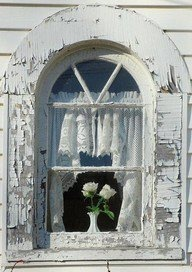 I love this window, the cracking paint, the architecture, but you better believe I wouldn't be caught dead with the paint on my house looking this bad! It's bad enough my barn needs paint! :) but, it IS pretty :)