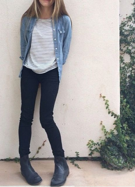 Black ankle boots, black skinny jeans, striped shirt, and chambray shirt.