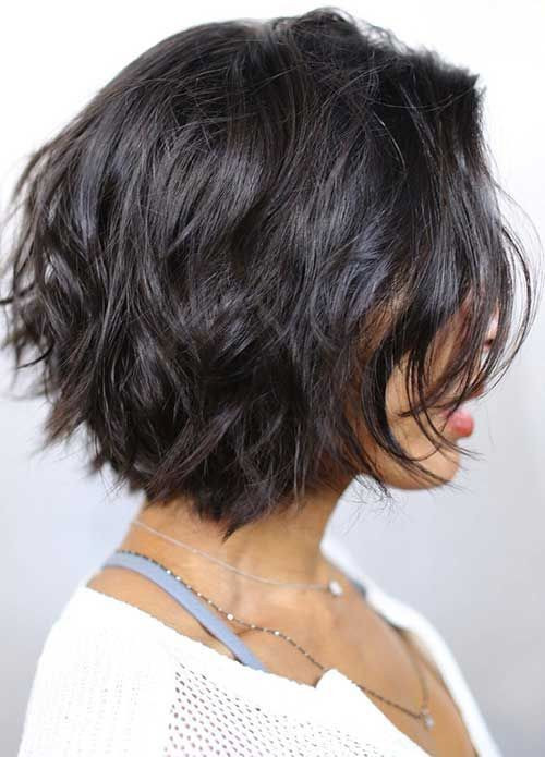 Chic short dark haircut with layers for women with thick hair