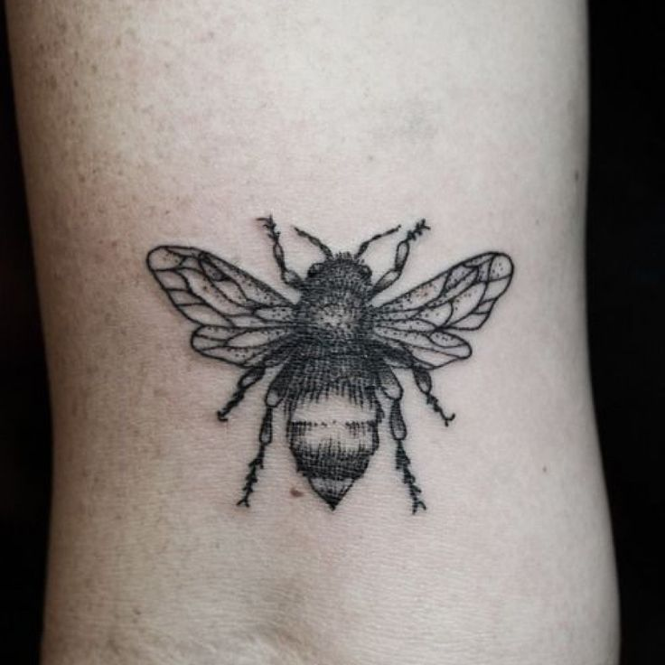 Grey Ink Bee Tattoo On Wrist                                                                                                                                                                                 More