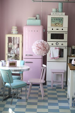Pretty retro kitchen in pastel shades--and check out that checkered floor! | Tiny Homes