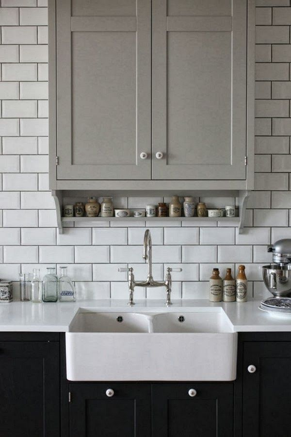 gray upper cabinet, black lower cabinet, farmhouse sink, subway tile