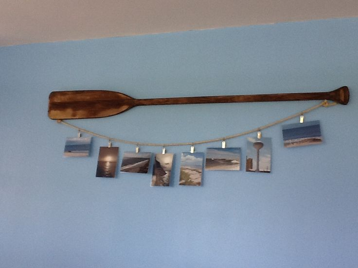 Boat Oar as picture hanger. Decor for beach/lake house.