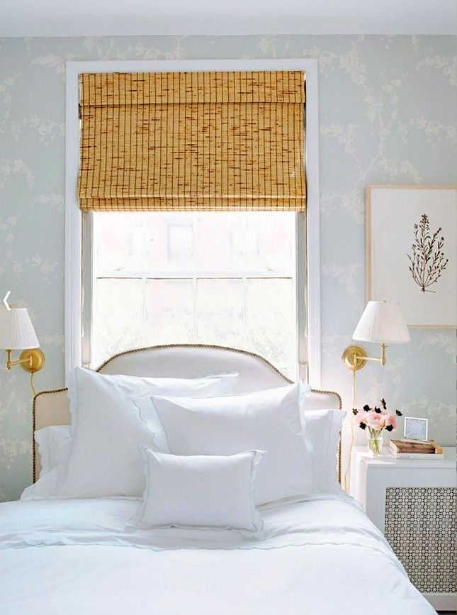 Love the wall sconces, window treatment, and linens.