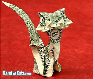 How to make a money origami cat from a dollar bill.