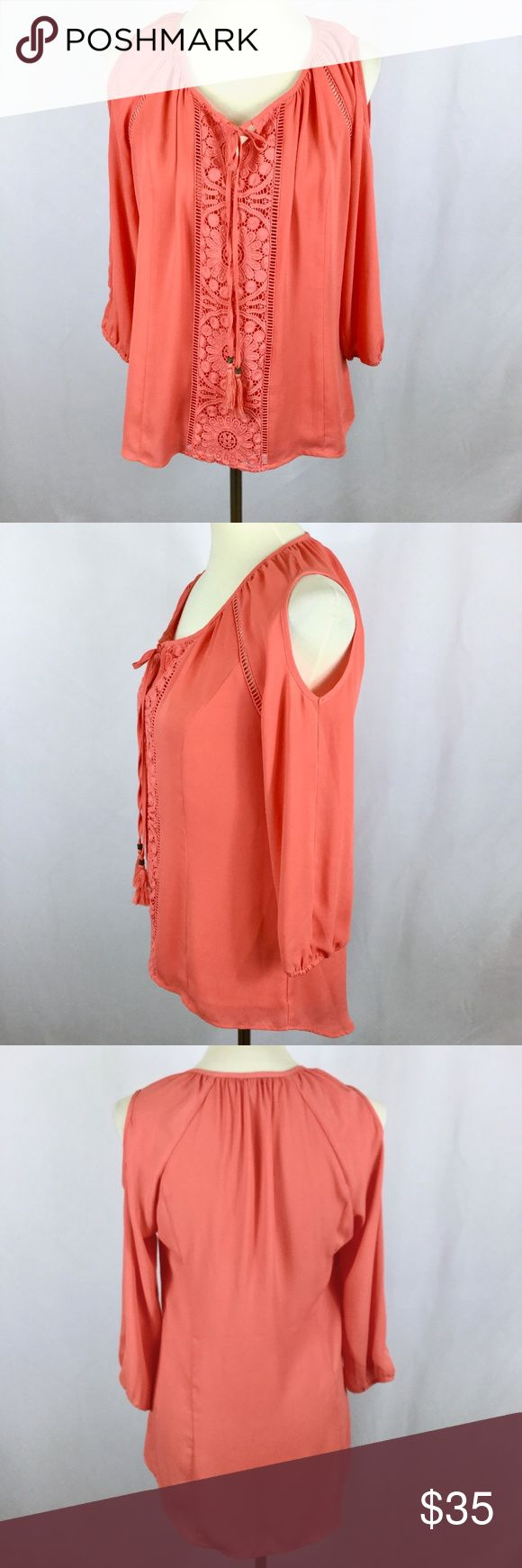 """Daniel Rainn Boho Cold Shoulder Peasant Blouse S Beautiful orange/coral peasant blouse by David Rainn in a cold shoulder style.  Lovely hand crochet lace cutout shapes near the sleeves and in a panel on the front, and two tasseled ties for the neckline. Puff poet sleeves with elasticized cuffs so you can push them up if you want. Bodice has a double layer of chiffon for modesty. Slight hi-low design, with the back longer than the front. New without tags.   Measurements: Bust: 38"""" Length: 26""""…"""
