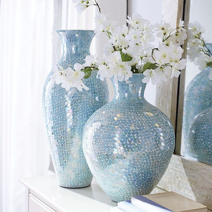 Aqua Mosaic Vases | Pier 1 Imports. Spectacular handcrafted iron vases clad in glittering glass mosaic bring a sun-kissed ocean vibe to your home or beach cottage. Love the aqua color.