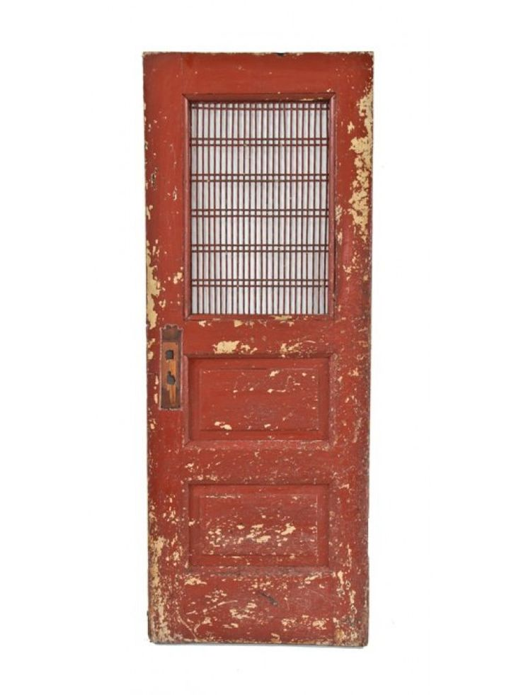 original and nicely distressed late 19th century painted mahogany wood reliance building raised panel utility door with overlapping wire mesh screen