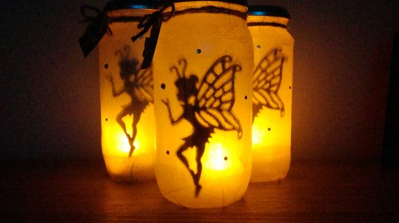 Magical Nightlight Fairy Lantern Jar available in either fairy or alien design. Comes in a choice of colours. Each jar is supplied with a warm flicker effect battery operated tealight which turns a beautiful jar by day into a stunning nightlight in the dark. Each jar is finished with a small gift tag displaying either a butterfly wooden button on the Fairy jar or a star button on the alien jar. The gift tags are secured with twine to the neck of the far. Each jar measures approximately 16cm…