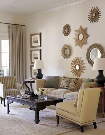 circular mirrors above the couch make the room look bigger and add art to the bare walls