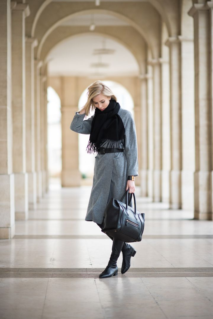 Grey cashmere cardigan with over the knee boots and a Céline mini luggage bag