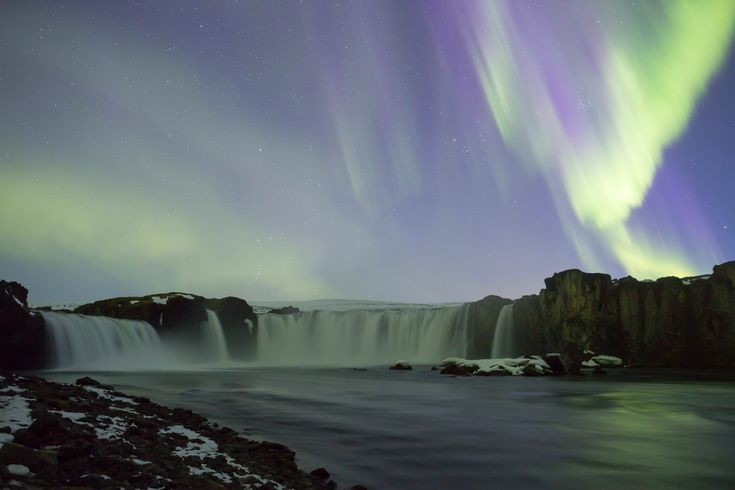 On our 8th night in Iceland we finally had clear skies and it happened to be during a KP7 solar storm. Here is the Aurora over Goðafoss in Northern Iceland [OC][5760x3840]