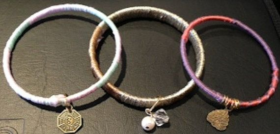 Handmade embroidery thread wrapped set of 3 bangle bracelets with charms and beads on Etsy, $10.00 CAD