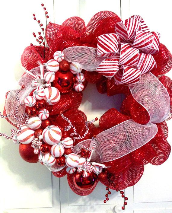 Large Red and White Christmas Peppermint Deco Mesh Wreath. Loaded with Christmas Ornaments and a Large Red and White Bow.