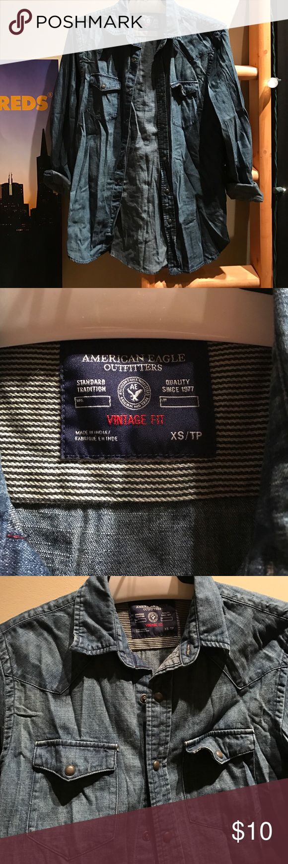 American Eagle Chambray/Denim Button up UNISEX American Eagle unisex button down chambray denim shirt. Men's XS. Cowboy? Hipster? Hipster cowboy all in one? This is the shirt for you. 🤠🤷♂️ American Eagle Outfitters Shirts Casual Button Down Shirts