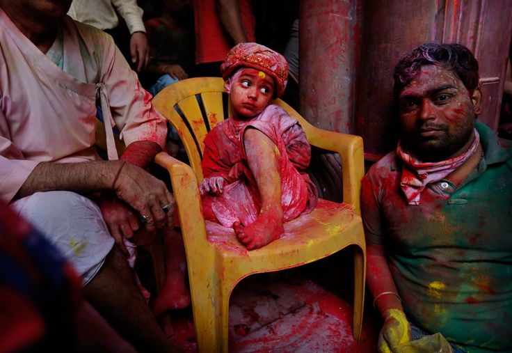 A young Hindu devotee sits covered in colored dye at the Banke Bihari temple, dedicated to Lord Krishna, during Holi festival celebrations in Vrindavan, India, March 26, 2013. (Kevin Frayer/Assoicated Press)#