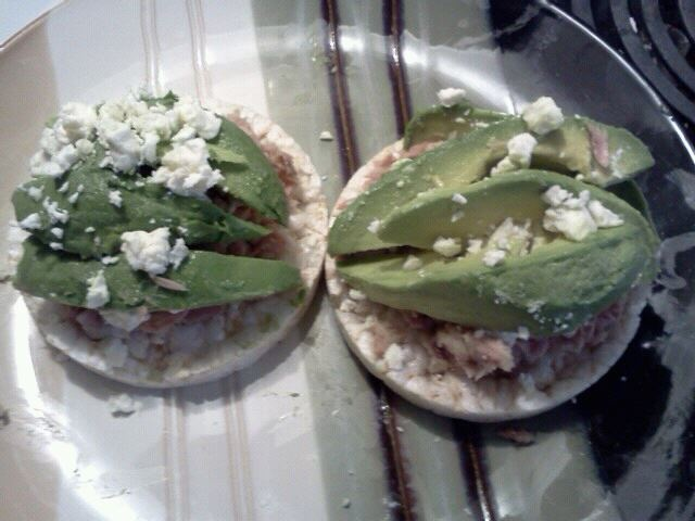 2 Quaker rice cakes with 1 can of light tuna in water (drained), 1 haas avocado, and crumbled feta. SUPER YUMMY!!!