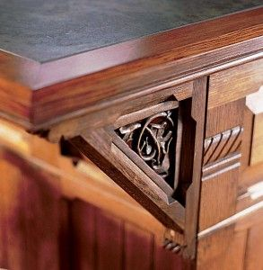 Charming A Bracket With A Carved Leaf And Vine Motif Supports An Island Countertop.