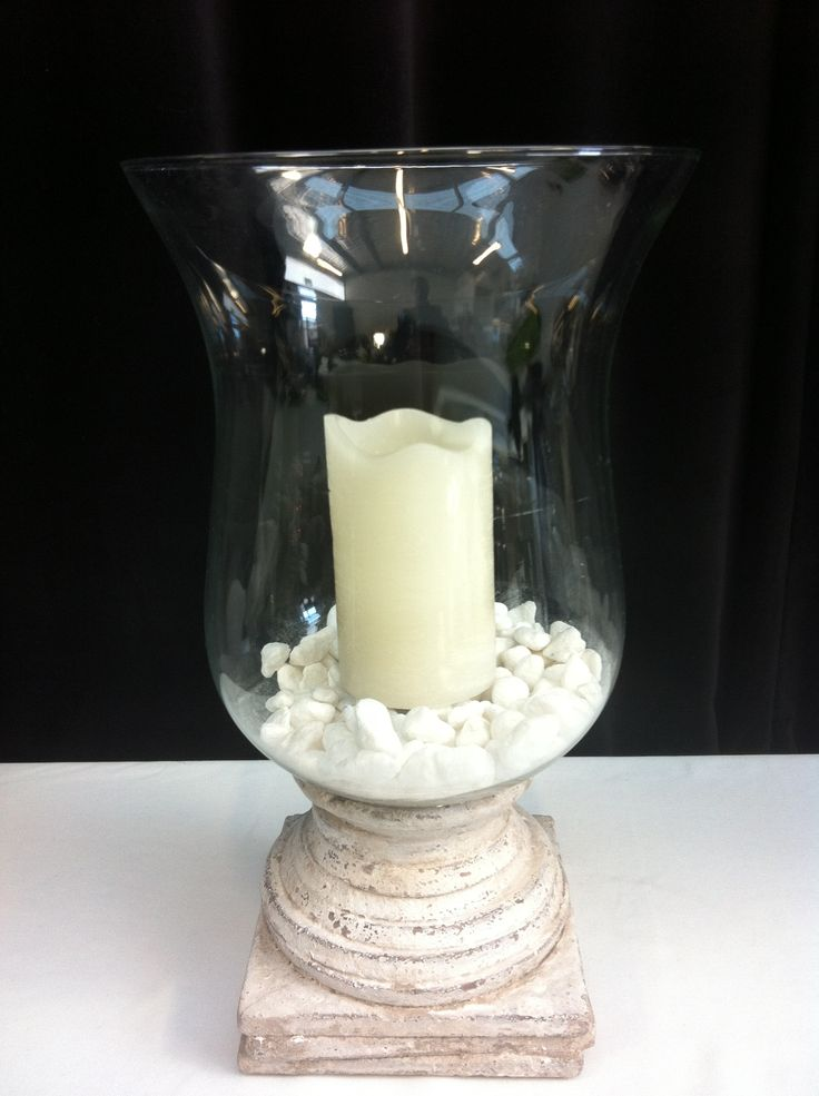 White stone based hurricane with pebbles and candle Presented on mirror base with tea lights