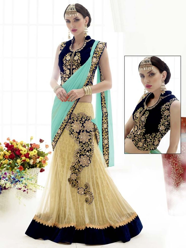 Prodigious cream and aqua color lehenga style net saree with stone, resham work. Item code: SAV3809 http://www.bharatplaza.com/new-arrivals/sarees.html