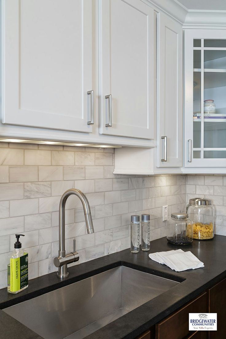 White marble subway backsplash tile countertop espresso cabinet from - Black Honed Granite Counter Tops With White Carrera Marble Backsplash