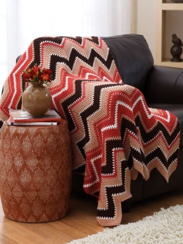 Free Pattern - Thick and thin stripes have dynamic appeal in this energizing autumn-inspired #crochet afghan.