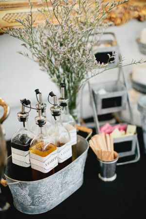 Coffee Syrups in Galvanized Bucket | photography by http://www.kristynhogan.com/ | Venue, Floral, Event Styling, Decor, and Custom Signage by http://www.cedarwoodweddings.com/