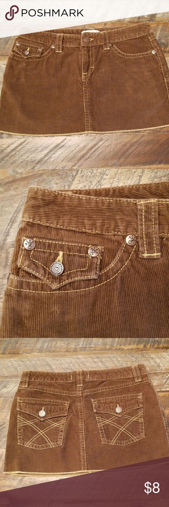 AÉROPOSTALE CORDORUY MINI SKIRT BROWN WITH GOLD STITCHING  *Length- 11 1/2 inches * 2 Back Button Pockets * 2 Front Deep Pockets- Right pocket has a smaller pocket  *Zipper/button closure  FABRIC CARE: *100% Cotton * Machine Washable  *EUC Aeropostale Skirts Mini