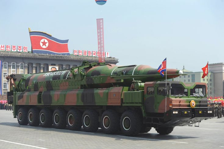 Misguided: A North Korean military vehicle carries what is believed to ...