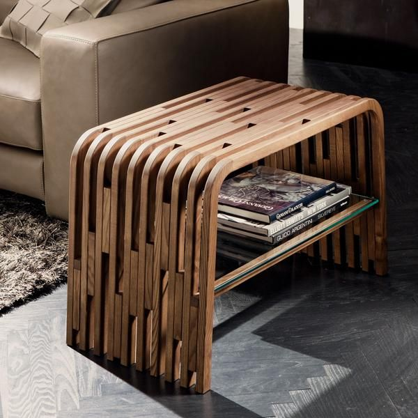 Made to order in Italy, the Millerighe side table is a stunning piece of modern design from Pacini e Cappellini. Natural variations of the wood are highlighted with the slim strips of wood.