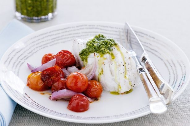 This fish dish gets great colour from sweet tomato and red onion, and rich, nutty pesto.