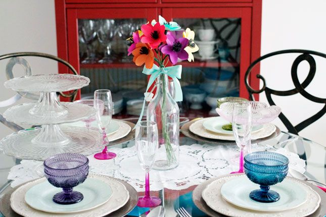 Colourful stemware and sorbet dishes lend little pops of colour to this pretty tablescape.