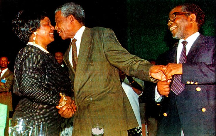 Nelson Mandela is congratulated by wife Winnie after the 1991 unanimous decision for him to succeed Oliver Tambo as ANC President.