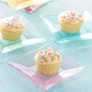 Dreamy Orange Cupcakes Recipe -The classic vanilla-orange flavor combination comes through in these yummy cupcakes made for the lactose-intolerant. Sprinkles add a touch of fun to these travel-ready treats. —Taste of Home Test Kitchen