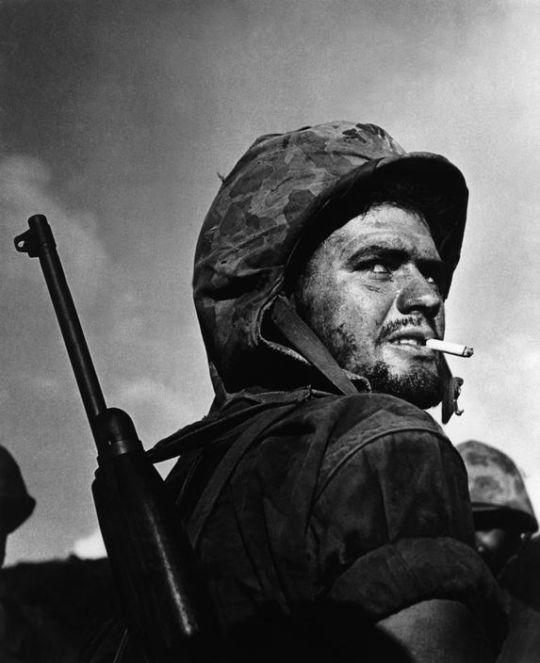 A U.S. Marine during the Battle of Saipan. June 27, 1944. Photo by W. Eugene Smith.