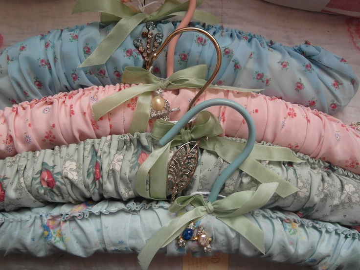 padded coat hangers with vintage brooches