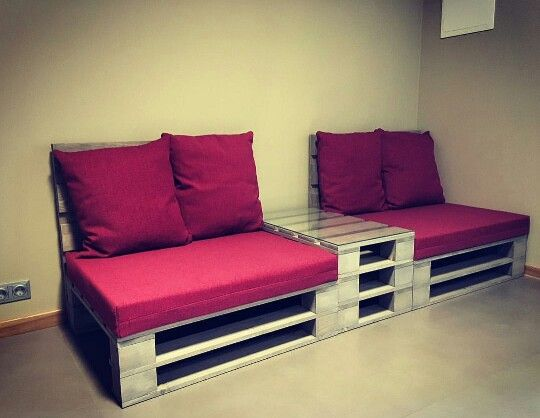 Concept 1 part 2 - precedent.  Seating made of wooden pallettes, glass and cushions.