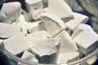 Marshmallow from scratch - no corn syrup  The ingredients for this recipe are:      3/4 cup water     2 x 28 Gram packets of gelatin (2 x 1 Oz. )     2 cups granulated sugar     1/2 cup water     1 teaspoon vanilla extract     1 pinch salt     Powdered sugar (for dusting the sticky goo)  If you had enough corn and corn syrup in your life, you might appreciate that this recipe has none.