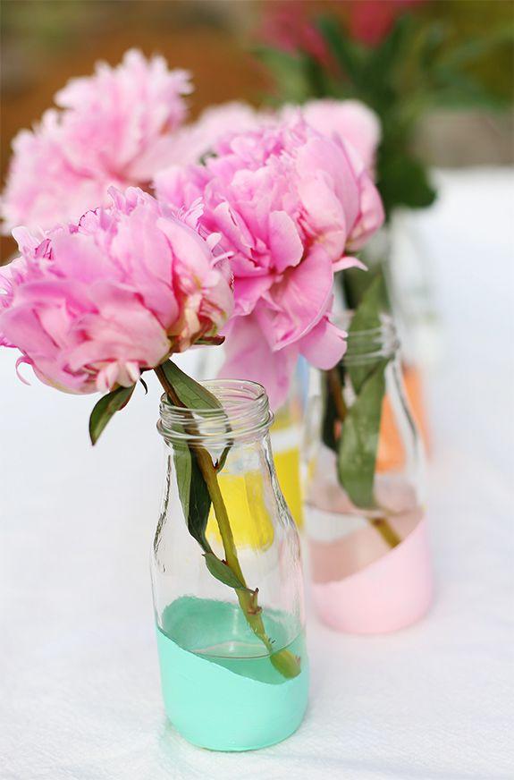 simple centerpiece idea: pastel dipped milk glasses, then add a flower.
